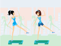 Girls doing exercise on aerobic step Stock Image