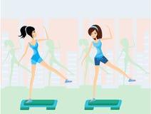 Girls doing exercise on aerobic step Stock Image