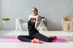 Women doing exercises aerobics warming up with Royalty Free Stock Photography