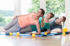 Women doing exercises for pelvis floor in postnatal regression c Stock Photography