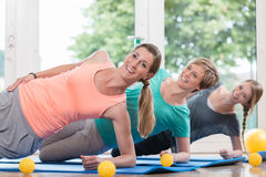 Women doing exercises for pelvis floor in postnatal regression c Royalty Free Stock Image