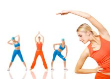 Women doing fitness exercise. Group of women doing fitness exercise isolated on white. Lots of possibilities to put your text on Stock Photos