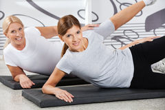 Women doing fitness training in gym royalty free stock photo