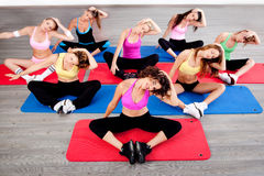 Women doing floor exercise Stock Photo