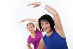 Women doing gymnastics Stock Photography