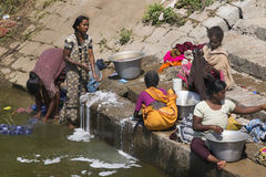 Women doing laundry on the steps of the ghat. Royalty Free Stock Photography
