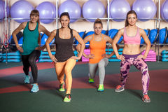 Women doing a leg exercise in aerobics class Royalty Free Stock Image