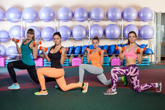 Women doing a leg exercise in aerobics class Stock Photography