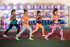 Women doing a leg exercise in aerobics class Stock Photo