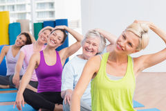 Women doing neck exercise at fitness club Royalty Free Stock Photography