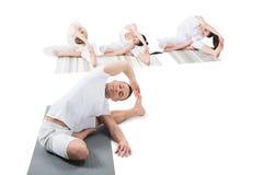 Women doing Revolved Head-to-Knee Pose parivrtta janu shirshasana Stock Images
