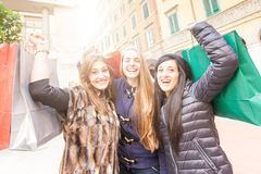 Women doing Shopping. Happy Women with Shopping Bags in the City stock photography