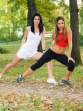Women doing sports outdoors Royalty Free Stock Photos