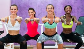 women doing squats holding dumbbells at functional training grou royalty free stock photo