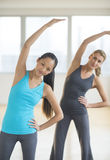 Women Doing Stretching Exercise At Gym Stock Photography