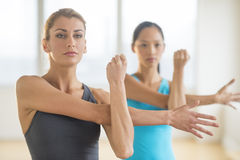 Women Doing Stretching Exercise At Gym royalty free stock photography