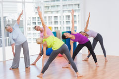 Women doing stretching exercise in gym Stock Photography