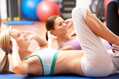 Women Doing Stretching Exercises Stock Photos