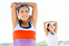 Women doing stretching exercises Stock Image