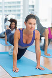 Women doing stretching exercises in fitness studio Royalty Free Stock Photos