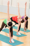 Women Doing Stretching Exercises In Gym. Royalty Free Stock Photography