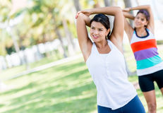 Women doing stretching exercises Royalty Free Stock Photography