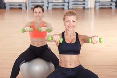 Women doing weights fitness on balls Royalty Free Stock Photo