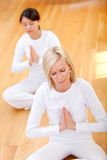 Women doing yoga Stock Images