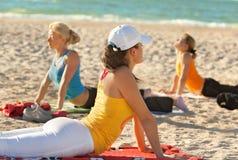 Women doing yoga exercise Royalty Free Stock Images