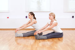 Women doing yoga exercise at gym Stock Photography