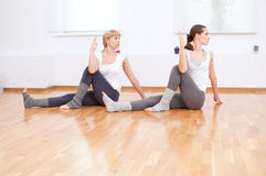 Women doing yoga exercise at gym Royalty Free Stock Image