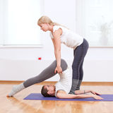 Women doing yoga exercise at gym Royalty Free Stock Photos