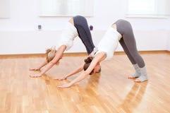 Women doing yoga exercise at gym Royalty Free Stock Photos