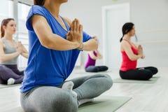 Women Doing Yoga. Group Of Women Doing Yoga Indoors Stock Photography