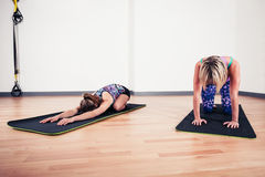 Women doing yoga in gym Royalty Free Stock Images