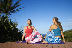 Women Doing Yoga Outdoors Stock Images