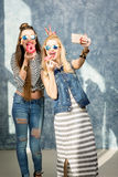 Women with donuts Stock Photography
