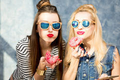 Women with donuts Royalty Free Stock Images