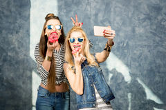 Women with donuts Royalty Free Stock Image