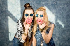 Women with donuts Royalty Free Stock Photography