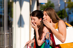Women downtown shopping with bags Stock Photos