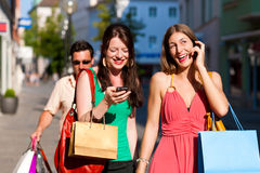 Women downtown shopping with bags Stock Photo