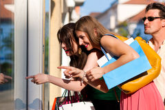 Women downtown shopping with bags Royalty Free Stock Photo