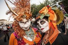 Women in Dramatic Dia De Los Muertos Makeup Stock Photo