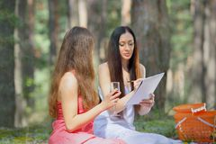 Women draw on a picnic Stock Images