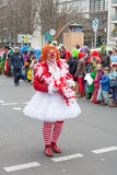 Women dressed as a clown at carnival procession Royalty Free Stock Photography
