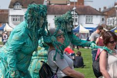 Women dressed as green witches scare passersby with props including a spider and radius ulna. Stratford upon Avon Warwickshire England UK April 21st 2018 stock photos