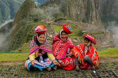 Women dressed in traditional clothes at festival in Machu-Picchu, Peru