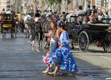 Women dressed in traditional costumes in Seville Spain Royalty Free Stock Image