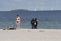 Women dressed in traditional Islamic dress on beach. COPENHAGEN, DENMARK - July 28, 2016: Women dressed in traditional Islamic dress were seen walking at Royalty Free Stock Photo